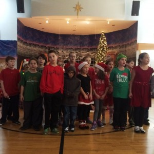 The 4th graders sang a song from their Dec mass.