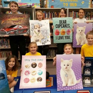 Winners of the displayed Book Fair posters.