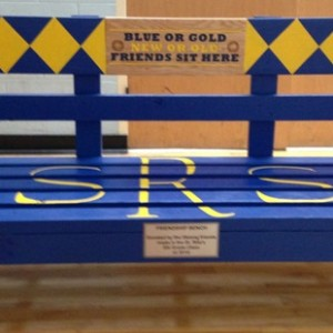 A friendship bench sits in the entry to the Parish center.
