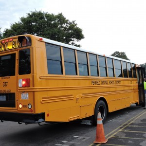 Coach M welcomes the 1st bus.
