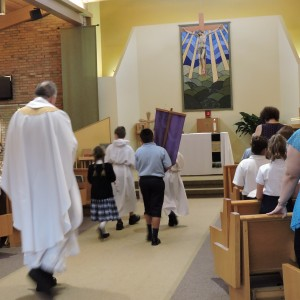 Entering church for the beginning of mass.