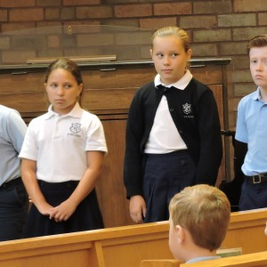 Students waiting to do the opening announcements and introductions.