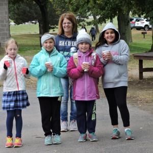 They are off for mile #2 with hot chocolate in hand.