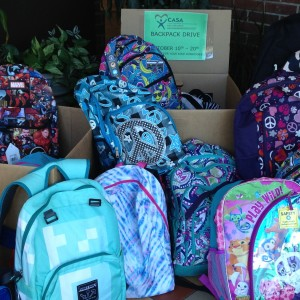 Just some of the 75+ backpacks donated to CASA from our Fall Service project.