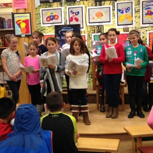 The 5th grade Girl Scout troop say carols as part of the evening.