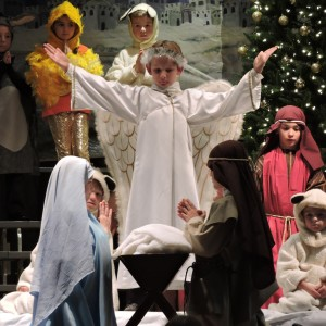 The announces the birth of Christ to all.