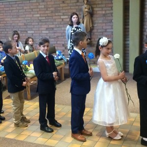 The 2nd graders getting ready to enter church for May Day