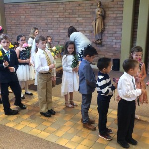 Class representatives with the various flowers that honor Mary