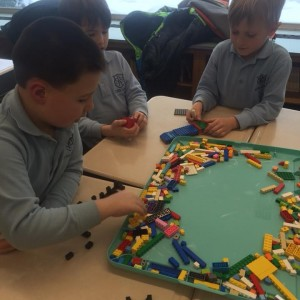 Lego League 1st graders working hard on their project.
